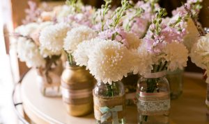 White Dahlia in small jars Wedding Flowers