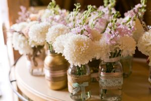 White Dahlia in small jars Wedding Flowers