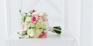 Bridal Bouquet with ribbon on white cross back chair