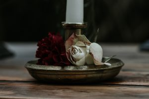 Winter wedding styling- roses and brass candlestick