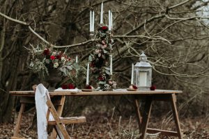 Winter Wedding table inspiration with red roses and candlesticks
