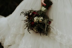 Winter Wedding Bouquet with red and white roses and winter berries