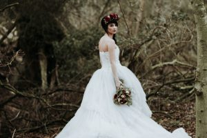 Winter bride with red flower crown and red rose bouquet