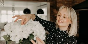 Essex wedding planner Hayley Jayne arranging flowers at wedding