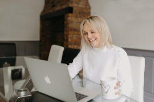 Essex wedding planner Hayley Jayne Weddings & Events working on laptop