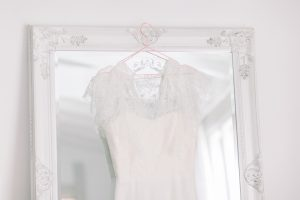 Wedding dress, hanging on a full length mirror | Essex Wedding Planner
