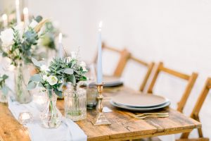 Wedding Table with table runner and bud vases filled with flowers | Essex Wedding Planner
