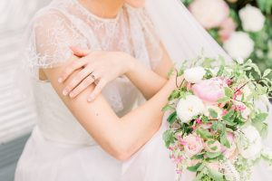 Bride's arms holding a bouquet | Essex Wedding Planner