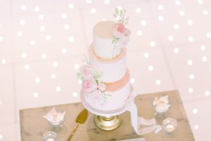 Pink wedding cake on a dessert table | Essex Wedding Planner