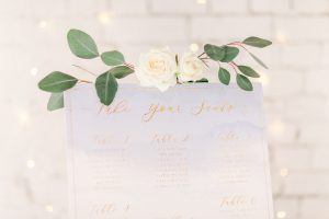 Gold & Blue Wedding Seating Plan with white and green flowers   Essex wedding planner