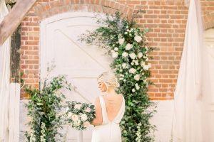 Floral arch & bride