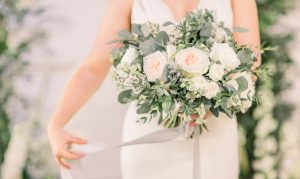 Bride holding her wedding bouquet with cascading silk ribbon