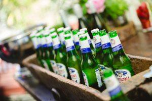 Wedding drink ideas-bottles of beer in a trough-DIY wedding bar