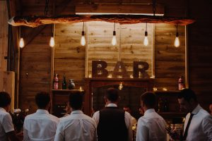 Wooden rustic bar with edison lighting-DIY bar