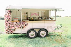 Mobile horse box bar with pink flowers | Essex Wedding Planner