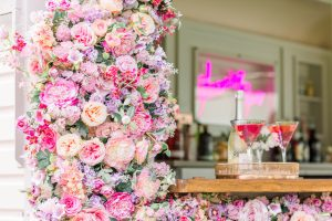 Two cocktails on mobile bar with pink flowers | Essex Wedding Planner