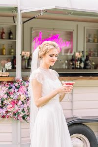 Bottles of prosecco in ice buckets surrounded by flower ice cubes | Essex Wedding Planner