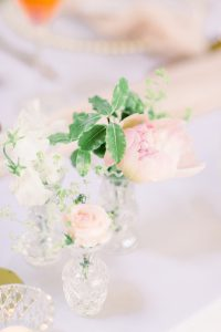 Flowers in small bud vases on wedding top table | Essex Wedding Planner