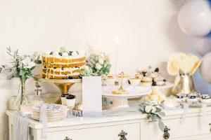 Gold and blue dessert table for your wedding day with blue silk runner
