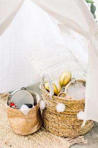 Children's toys in a wicker basket for a wedding day | Essex Wedding Planner