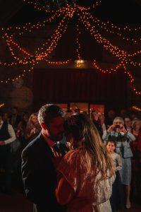 Bride & Groom Dancing under fairy lights-Essex Wedding Planner