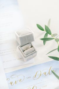 Engagement inspiration grey velvet ring box with blue and gold wedding stationery