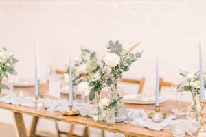 Vintage wood trestle table with powder blue decorations | Essex Wedding Planner