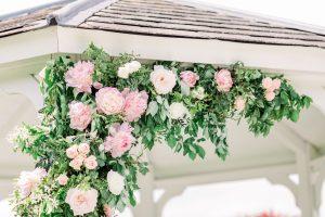 Pink Flowers on wedding gazebo | Essex Wedding Planner