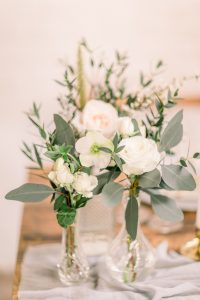 White & green flowers in vases | Essex wedding planner