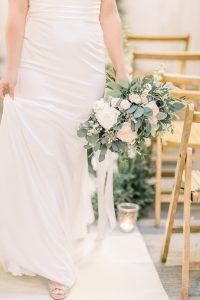 bride walking down the aisle with wedding bouquet | Essex wedding planner