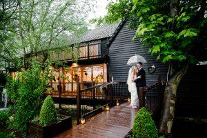 Bride & Groom in the rain | Essex Wedding Planner