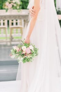 Bride holding bouquet | Essex Wedding Planner