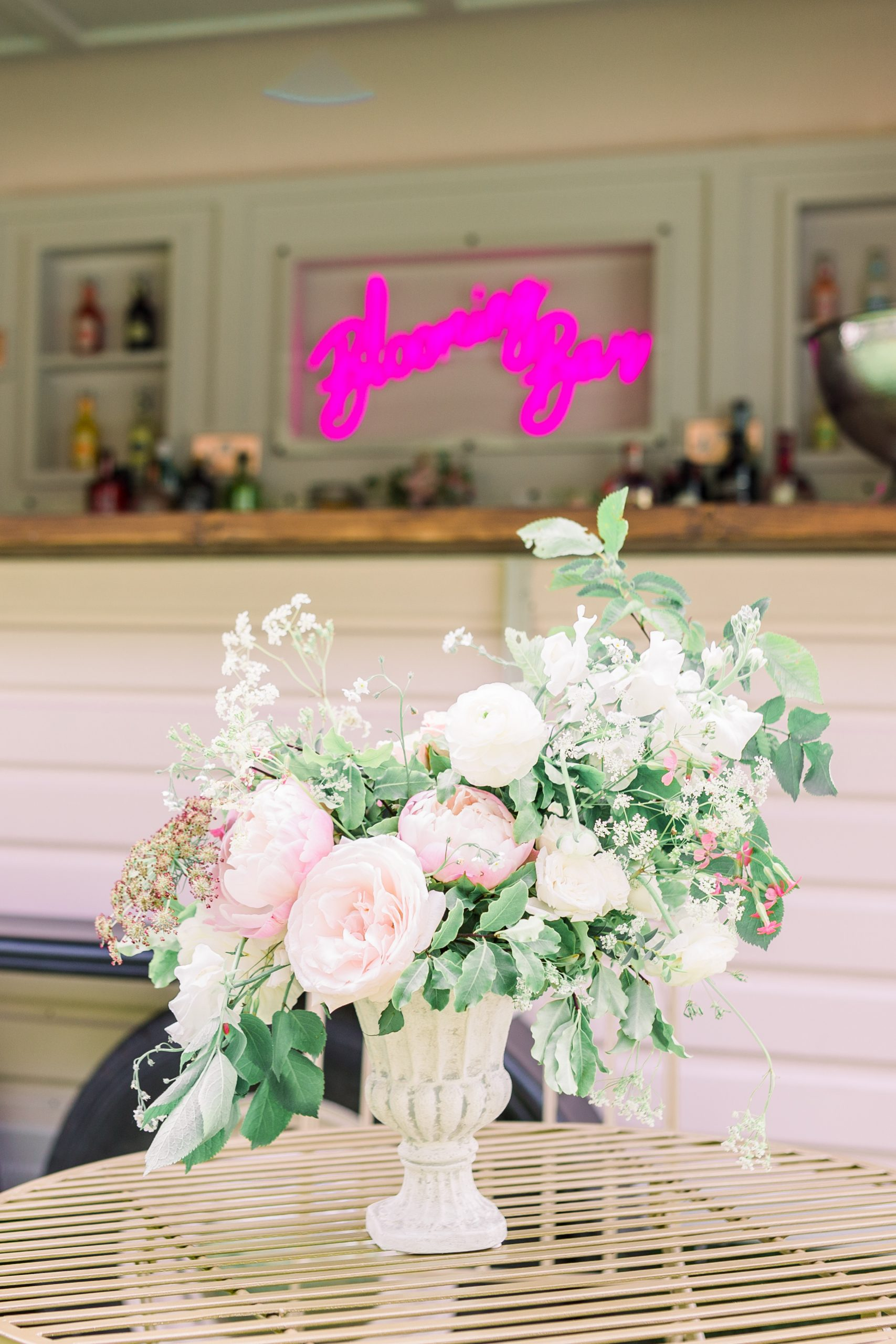 Flowers in urn in front of mobile bar | Essex Wedding Planner