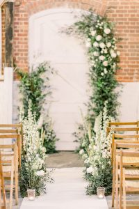 Wedding aisle styled with green and white flowers | Essex Wedding Planner