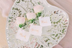 Rose buttonholes on a heart shaped silver plate | Essex Wedding Planner