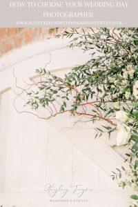 Foliage & white flowers framing white wooden door | Essex Wedding planner