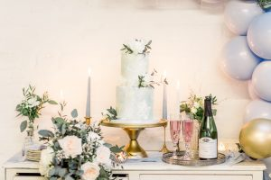 Wedding cake with bouquet & bottle of fizz | Essex Wedding Planner