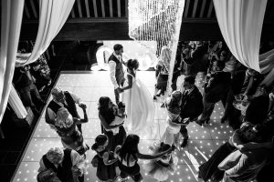 Bride & groom dancing with their guests | Essex wedding planner