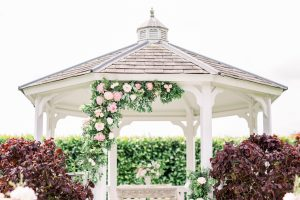 Outside wedding ceremony set up with pink flowers