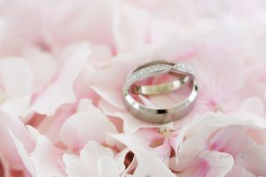 Wedding Rings On Pink Petals | Essex Wedding Planner